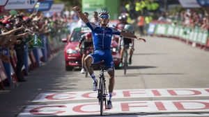 France's Julian Alaphilippe celebrates taking the eighth stage at the Vuelta a Espana