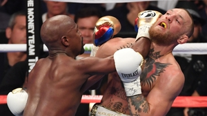 Mayweather and McGregor in action
