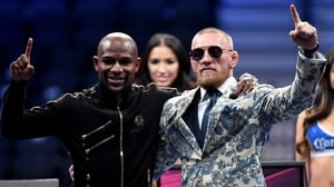 Floyd Mayweather (L) with Conor McGregor after their fight
