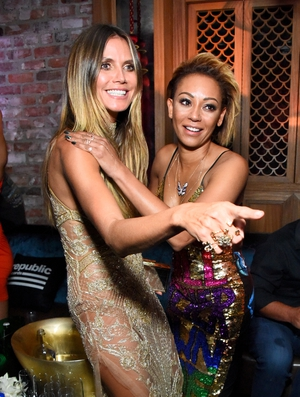 Heidi Klum looked gorgeous while Mel B wore a sequined Discount Universe dress that says 'You will never own me'.