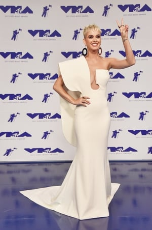 Host Katy Perry wore a beautiful, structured white gown by Stéphane Rolland to the VMAs.