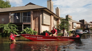 A Clark County Rescue boat helps people from their home