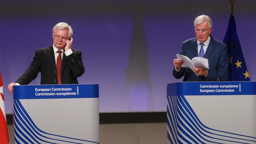EU's chief negotiator Michel Barnier (R) and his British counterpart David Davis speaking at a joint news conference