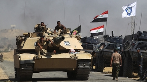 Iraqi forces take position on a road as they advance towards Al-Ayadieh village, the last remaining active front line near Tal Afar