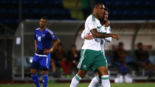 Josh Magennis and Oliver Norwood celebrate after the former scored Northern Ireland's second goal