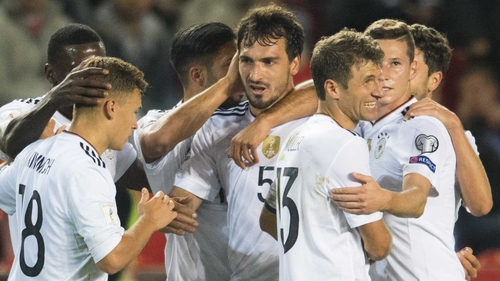 Mats Hummels is congratulated by his team-mates