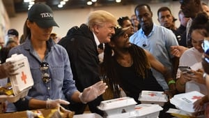 Donald and Melania Trump serve food at an emergency shelter in Houston today