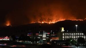 The La Tuna Canyon fire burns in the hills above Burbank, California