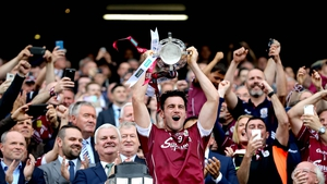 Galway captain David Burke hoists the silverware in the Hogan Stand in 2017