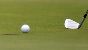 Sergio Garcia of Spain (not pictured) putts with an iron on the 18th green