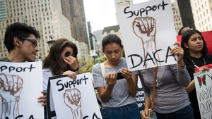 A group of 'dreamers' originally from Ecuador watch Attorney General Jeff Sessions' remarks