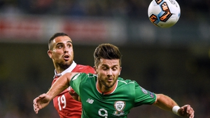 Shane Long under pressure from Nikola Maksimovic of Serbia