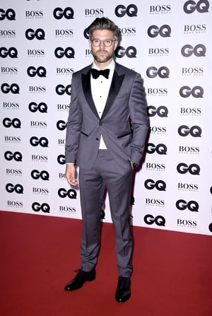 Darren Kennedy wore a Hugo Boss grey tuxedo with black lapels and a velvet bow tie and black shoes with suede.