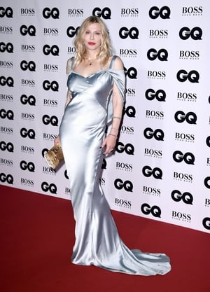 Courtney Love wore a floor length silk gown with a red lip and loose blonde waves.