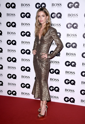 Peaky Blinders actress Annabelle Wallis wore a gold Chanel dress with matching Jimmy Choo heels.