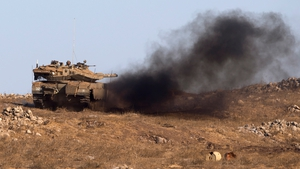 An Israeli army tank taking part in a military exercise near the Israeli-Syrian border yesterday