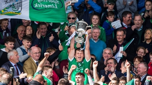 Limerick captain Tom Morrissey lifts the trophy