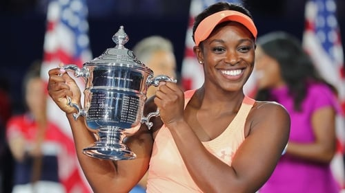 Sloane Stephens poses with the trophy