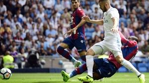 Karim Benzema (2L) vies with Levante's Colombian midfielder Jefferson Lerma (R)
