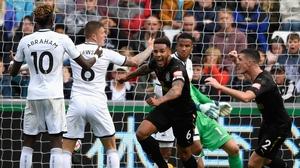 Newcastle goalscorer Jamaal Lascelles wheels away in celebration
