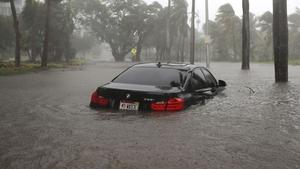 A car is seen on a flooded street as Hurricane Irma passes through