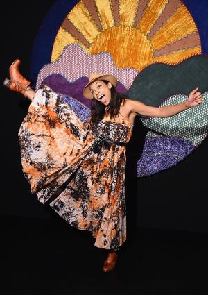 Rosario Dawson looks like she's having a ball at the Anna Sui fashion show.