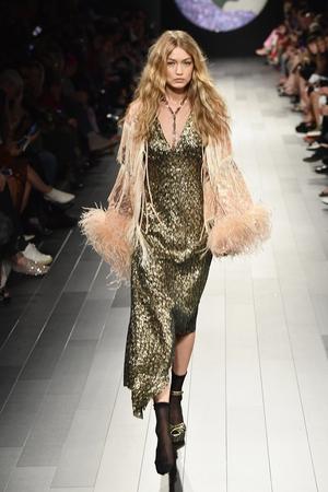 Model Gigi Hadid looks ready for Coachella on the Anna Sui runway.