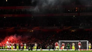Cologne fans let off flares after Jhon Cordoba's goal at the Emirates