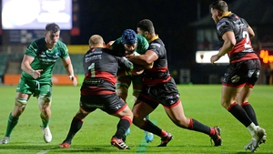 John Muldoon is tackled by Leon Brown and Brok Harris