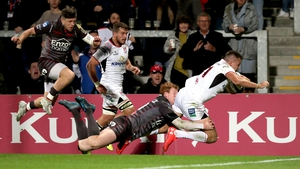 Jacob Stockdale scores a try despite the attention of Rhys Patchell