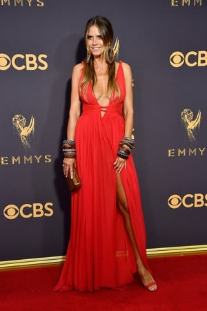 Model Heidi Klum wore a red Dundas dress with jewellery from Lorraine Schwartz and Swarovski
