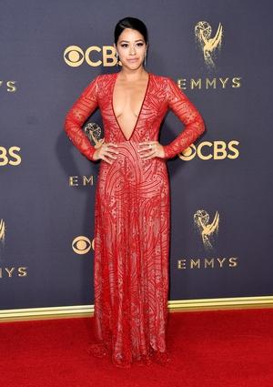 Gina Rodriguez wore a revealing floor length dress from Naeem Khan.