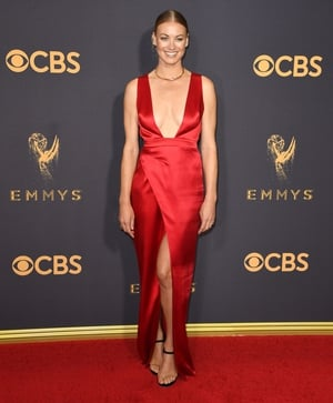 It should come as no surprise that Handmaid's Tale actress Yvonne Strahovski wore red on the night. She wore a custom Julien Macdonald gown and Cartier jewellery.