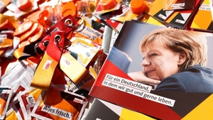 German chancellor Angela Merkel on brochures and election paraphernalia. Photo: Felipe Trueba/EPA