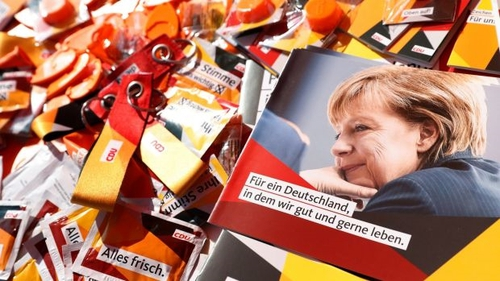 German chancellor Angela Merkel on brochures and election paraphernalia. Photo: Felipe Trueba/EPA