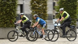 Boylan, centre, cycling through Dublin