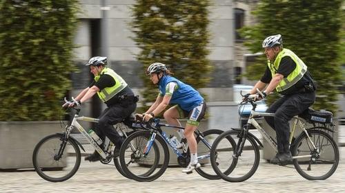 Boylan, centre, cycling through Dublin
