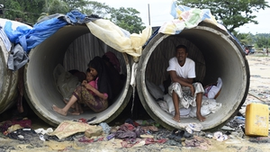 Rohingya refugees shelter in cement pipes at a refugee camp in Bangladesh