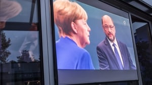 Chancellor Angela Merkel (L) and her main election rival Martin Schultz in tv debate from earlier in the campaign