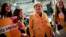 German Chancellor Angela Merkel poses with CDU party campaigners