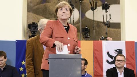 Merkel wins fourth term as far-right enters German parliament | RTÉ News