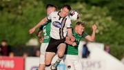 Dundalk's David McMillan with Conor McCormack and Ryan Delaney of Cork City from their clash in June