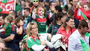 A young Mayo supporter cheers on her team