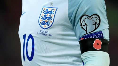 Wayne Rooney wearing a poppy during the World Cup qualifier between England and Scotland last November