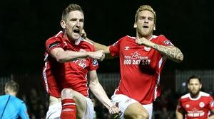 Ian Bermingham (L) celebrates his goal against Shamrock Rovers