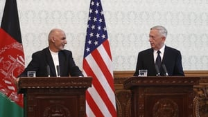 Afghan President Ashraf Ghani (L) talks to James Mattis during a joint press conference in Kabul