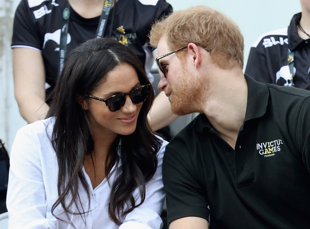 Prince Harry (R) and Meghan Markle (L) attend a Wheelchair Tennis match during the Invictus Games 2017