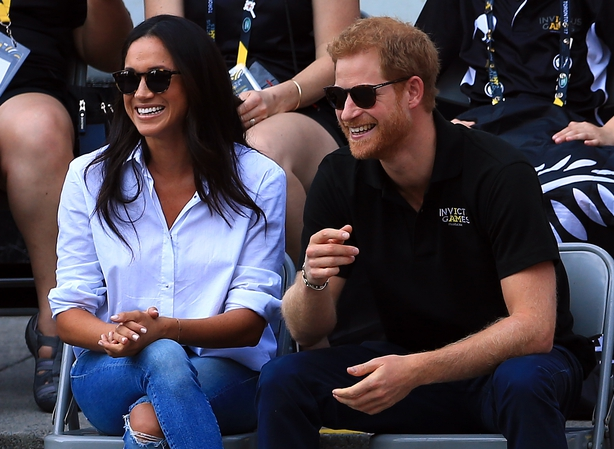 Prince Harry (R) and Meghan Markle