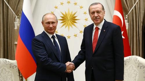 Vladimir Putin and Recep Erdogan pose before their meeting in Ankara