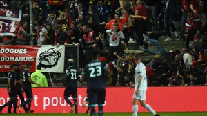 Chaotic scenes as Lille supporters fall through a barrier following Fode Ballo-Toure's goal